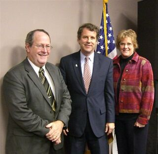 "OPA Executive Director Ernest Boyd (left) and pharmacist wife Twila thank Senator Sherrod Brown for his sponsorship of the ""tamper-resistant"" legislation."
